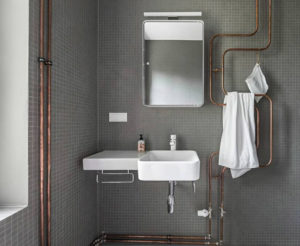 Exposed pipe feature and towel warmer Bathroom